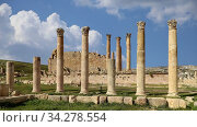 Roman ruins in the Jordanian city of Jerash (Gerasa of Antiquity), capital and largest city of Jerash Governorate, against the background of moving clouds, Jordan. Стоковое видео, видеограф Владимир Журавлев / Фотобанк Лори