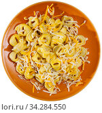 Tortellini garnished with grated cheese and pignoli. Стоковое фото, фотограф Яков Филимонов / Фотобанк Лори
