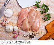 Купить «Raw chicken fillets and condiments», фото № 34284794, снято 3 августа 2020 г. (c) Яков Филимонов / Фотобанк Лори
