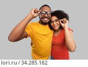 happy african american couple in glasses hugging. Стоковое фото, фотограф Syda Productions / Фотобанк Лори