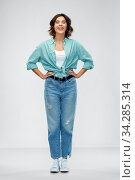 Купить «smiling young woman in turquoise shirt and jeans», фото № 34285314, снято 18 апреля 2020 г. (c) Syda Productions / Фотобанк Лори