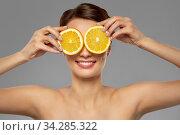 Купить «beautiful woman making eye mask of orange slices», фото № 34285322, снято 30 ноября 2019 г. (c) Syda Productions / Фотобанк Лори
