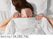 Купить «woman with eye sleeping mask in bed under blanket», фото № 34285742, снято 22 января 2020 г. (c) Syda Productions / Фотобанк Лори