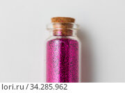 pink glitters in bottle over white background. Стоковое фото, фотограф Syda Productions / Фотобанк Лори