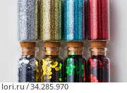 set of glitters in bottles over white background. Стоковое фото, фотограф Syda Productions / Фотобанк Лори