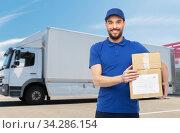 happy delivery man with parcel boxes. Стоковое фото, фотограф Syda Productions / Фотобанк Лори