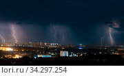 Several bright lightning bolts strike the ground in the city. Стоковое фото, фотограф Константин Шишкин / Фотобанк Лори