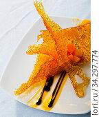 Купить «Close up of dessert of sweet carrots cubes with caramel and vanilla sauce», фото № 34297774, снято 2 августа 2020 г. (c) Яков Филимонов / Фотобанк Лори