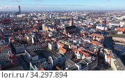 Scenic view from drone of historical Market Square with Old Town Hall and massive Gothic church of St. Elizabeth in spring, Wroclaw, Poland. Стоковое видео, видеограф Яков Филимонов / Фотобанк Лори
