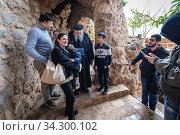 Father Dario Escobar Maronite monk meets with tourists in his hermitage of Our Lady of Hawqa in Kadisha Valley also called Holy Valley in Lebanon. Редакционное фото, фотограф Konrad Zelazowski / age Fotostock / Фотобанк Лори