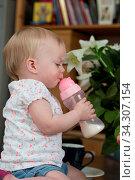 Купить «Child drinking milk from bottle, adorable and cute baby portrait», фото № 34307154, снято 5 августа 2020 г. (c) easy Fotostock / Фотобанк Лори