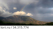 Beautiful clouds and rainbow over the mountain Demerdzhi in Crimea. Стоковое фото, фотограф Яна Королёва / Фотобанк Лори