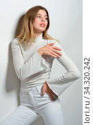 Portrait of the sexy beautiful woman with long blonde hair in white clothes posing in studio with white background. Стоковое фото, фотограф Zoonar.com/© Dmitry Raikin / easy Fotostock / Фотобанк Лори