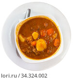 Купить «Stewed lentils with pork and vegetables», фото № 34324002, снято 3 августа 2020 г. (c) Яков Филимонов / Фотобанк Лори