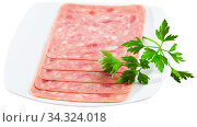 Sliced sausage from chopped pork meat isolated. Стоковое фото, фотограф Яков Филимонов / Фотобанк Лори