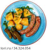 Купить «Appetizing sausages with potatoes and pickled cucumbers closeup», фото № 34324054, снято 3 августа 2020 г. (c) Яков Филимонов / Фотобанк Лори