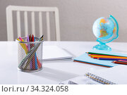 School stationery on desk. Стоковое фото, фотограф Яков Филимонов / Фотобанк Лори