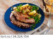 Купить «Served dish with fried pork, herbs and potatoes», фото № 34324154, снято 3 августа 2020 г. (c) Яков Филимонов / Фотобанк Лори