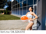 Woman with ball having a shower outdoors on resort. Стоковое фото, фотограф Tryapitsyn Sergiy / Фотобанк Лори