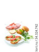 Купить «sandwich with fried bun, cheese spread and red fish in a plate», фото № 34324742, снято 18 апреля 2020 г. (c) Peredniankina / Фотобанк Лори