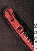 Red zipper of a fleece jacket, close-up. Стоковое фото, фотограф EugeneSergeev / Фотобанк Лори