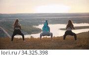Three young women doing aerobic exercises. Стоковое видео, видеограф Константин Шишкин / Фотобанк Лори