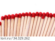 Close up view of a bunch of matches with red heads on a white background. Стоковое фото, фотограф Zoonar.com/Mauro Rodrigues / easy Fotostock / Фотобанк Лори