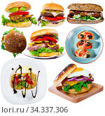Купить «Hamburgers, sandwiches and other fastfood dishes isolated on white background», фото № 34337306, снято 5 августа 2020 г. (c) Яков Филимонов / Фотобанк Лори