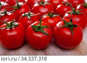 Tasty appetizing tomatoes on a wooden surface. Стоковое фото, фотограф Яков Филимонов / Фотобанк Лори