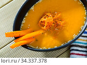 Купить «Tasty boiled vegetarian carrot cream soup served at plate on table», фото № 34337378, снято 4 августа 2020 г. (c) Яков Филимонов / Фотобанк Лори