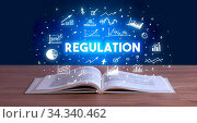 Купить «REGULATION inscription coming out from an open book, business concept», фото № 34340462, снято 5 августа 2020 г. (c) easy Fotostock / Фотобанк Лори