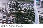 View of shelving rack with metal parts, steel profiles and sheets in metalworking workshop. Стоковое видео, видеограф Яков Филимонов / Фотобанк Лори