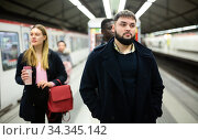 Young man waiting for train in underground station. Стоковое фото, фотограф Яков Филимонов / Фотобанк Лори