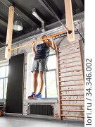 Купить «man exercising on bar and doing pull-ups in gym», фото № 34346002, снято 3 июля 2020 г. (c) Syda Productions / Фотобанк Лори