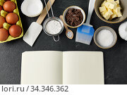 recipe book and cooking ingredients on table. Стоковое фото, фотограф Syda Productions / Фотобанк Лори