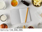 Купить «recipe book and cooking ingredients on table», фото № 34346386, снято 13 февраля 2020 г. (c) Syda Productions / Фотобанк Лори