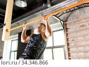 Купить «man exercising on bar and doing pull-ups in gym», фото № 34346866, снято 3 июля 2020 г. (c) Syda Productions / Фотобанк Лори