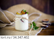 Homemade sweet yogurt with slices of ripe plums in a glass. Стоковое фото, фотограф Peredniankina / Фотобанк Лори