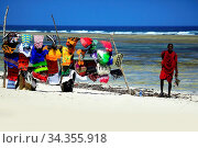 Купить «Brightly coloured beach towels displayed in the tourist popular resort...», фото № 34355918, снято 6 августа 2020 г. (c) easy Fotostock / Фотобанк Лори