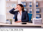 Купить «Middle-aged female employee suffering in the office», фото № 34359378, снято 5 августа 2020 г. (c) easy Fotostock / Фотобанк Лори