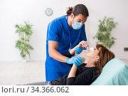 Купить «Young beautiful woman visiting doctor in plastic surgery concept», фото № 34366062, снято 10 сентября 2019 г. (c) Elnur / Фотобанк Лори