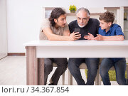 Grandfather learning new technology from son and grandson. Стоковое фото, фотограф Elnur / Фотобанк Лори