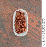 Kaffeebohnen in einer weißen Schale für die Food Fotografie Coffee... Стоковое фото, фотограф Zoonar.com/Volker Schlichting / easy Fotostock / Фотобанк Лори