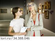 Woman and girl visiting museum. Стоковое фото, фотограф Яков Филимонов / Фотобанк Лори