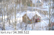 Winter snowfall. Fluffy snowflakes fly, whirl in wind. Cute wooden house in snow. Christmas defocused abstract background. New Year's Holidays. Background for advertising big winter sales and gifts. Стоковое видео, видеограф Dmitry Domashenko / Фотобанк Лори