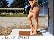 Female person with slim body having a shower. Стоковое фото, фотограф Tryapitsyn Sergiy / Фотобанк Лори