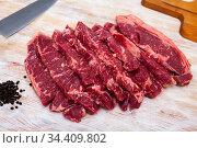 Sliced raw veal steak on wooden table. Стоковое фото, фотограф Яков Филимонов / Фотобанк Лори