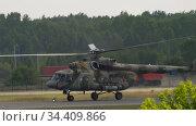 Military helicopter on runway. Редакционное видео, видеограф Игорь Жоров / Фотобанк Лори