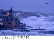 Porthleven clocktower and harbour at sunrise and high-tide during Storm Ciara, Cornwall, UK. February 2020. Стоковое фото, фотограф Ross Hoddinott / Nature Picture Library / Фотобанк Лори