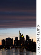 Germany, Frankfurt am Main - Skyline of the bank district in the city in the evening twilight, panoramic view from south direction over the Main river. Редакционное фото, агентство Caro Photoagency / Фотобанк Лори
